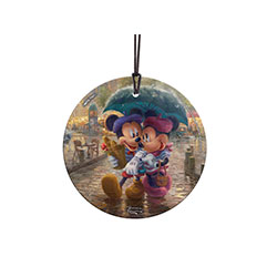 Disney's Mickey and Minnie Mouse share an umbrella on a Parisian cobblestone street in this image by Thomas Kinkade Studios. This StarFire Prints™ Hanging Glass collectible