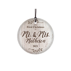 Congratulations! You're celebrating your first Christmas as a married couple! This sweet image of white wood and sprigs of nature, featuring your family name and year, is fused directly and permanently into glass for a light-catching keepsake.