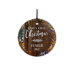 Celebrate a sweet little one's first Christmas with a dark wood style design and jewel-tone leaves. This hanging decoration is made of glass for a long-lasting, light-catching display.