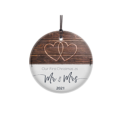 Congratulations! It's you're first year celebrating Christmas as a married couple! We're so happy for you! Commemorate the moment with this StarFire™ Prints Hanging Glass ornament featuring a rustic design on dazzling, light-catching glass.