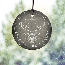 "Show off the most well-known Patronus in the Harry Potter Universe. The Stag Patronus takes center stage on the StarFire Prints Hanging Glass decoration, complete with the spell ""Expecto Patronum"" at the bottom."
