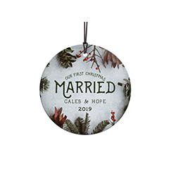 Congratulations! You're celebrating your first Christmas married! This frosty image with winter greens and cranberries, featuring your names and year, is fused directly and permanently into glass for a light-catching, long-lasting keepsake.