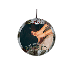 "Featuring a border of pinecones and evergreen tree branches, this 3.5"" circular glass ornament features the phrase ""Our First Christmas Married"", your wedding year and a circular-shaped space to upload your image."
