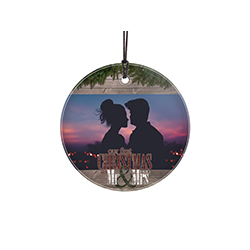 "Featuring a rustic farmhouse wood design, this 3.5"" circular glass ornament features the phrase ""Our First Christmas as Mr. and Mrs."", your wedding year and a space to upload your image."