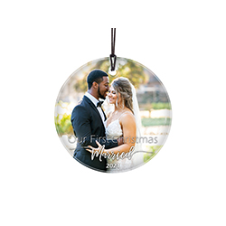 "This 3.5"" circular glass ornament features the phrase ""Our First Christmas Married"" and your wedding year. Add your favorite photo as the background of this minimalistic yet elegant design."