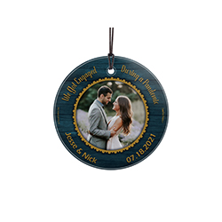 "This 3.5"" circular glass ornament features the phrase ""We Got Engaged During a Pandemic"" and places to enter your names and engagement date. Add your favorite photo to the center of this elegant design."