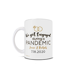 "This 11 oz ceramic coffee mug features the phrase ""We Got Engaged During a Pandemic"", a set of rings and places to enter your names and engagement date"