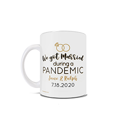 "This 11 oz ceramic coffee mug features the phrase ""We Got Married During a Pandemic"", a set of rings and places to enter your names and wedding date"