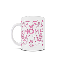 "Happy Mother's Day! This 11 oz ceramic mug features a white and pink design, resembling a symmetrical cutout pattern. If you look closely, you can see the word ""Mom"" along with designs of leaves, butterflies, flowers and more."