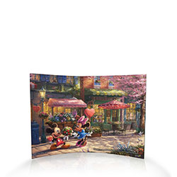 Spring and love are in the air with a colorful, charming scene that only the worlds of Thomas Kinkade Studios and Walt Disney could bring to life. Mickey surprises Minnie with a beautiful bouquet and a heart-shaped box of chocolates.