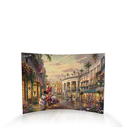 Thomas Kinkade Studios brings Disney's most loveable duo to Beverly Hills for some Rodeo Drive shopping! Minnie, in sweet polka dots, balances several shopping bags while Mickey reads the paper and, across the street, Donald and Daisy do some shopping