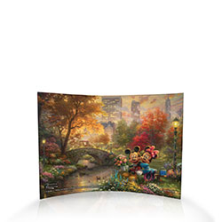 Disney's Mickey and Minnie Mouse share a sweet moment surrounded by the natural oasis of Central Park, in New York City. This image by Thomas Kinkade Studios is fused directly and permanently into the acrylic for a durable, light-catching, display