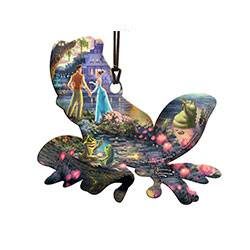 Tiana and Naveen share a moment on this frog-shaped acrylic. The Thomas Kinkade image based on the Disney movie is directly and permanently fused into acrylic. The result is a light-catching, scratch and fade-resistant collectible