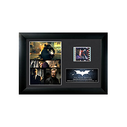 Relive the epic middle entry of Christopher Nolan's Batman Trilogy, The Dark Knight, with this FilmCells™ MiniCell featuring an image collage of the main characters from the film, a certificate of authenticity, and a clip of real 35mm film from the movie.