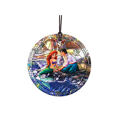 Disney's Little Mermaid is featured on this image by Thomas Kinkade, in a stained-glass style. The officially licensed hanging glass collectible shows Ariel, in mermaid form, and Prince Eric looking happily into each others' eyes.