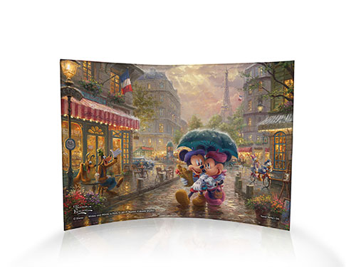 Disney's Mickey and Minnie Mouse take to the streets of Paris, berets, baguettes, and all.  Alongside the Parisian cobblestone street, friends like Goofy and Donald and Daisy Duck are enjoying their own moments in the City of Love.