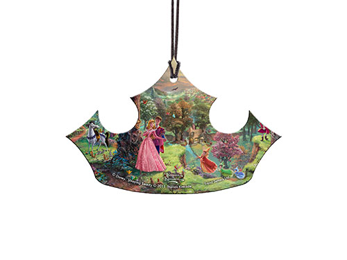 Disney's Sleeping Beauty, by Thomas Kinkade, is featured on this crown-shaped acrylic collectible. Aurora and Prince Phillip, along with other beloved Sleeping Beauty characters, are surrounded by color and light recognizable as a work by Thomas Kinkade