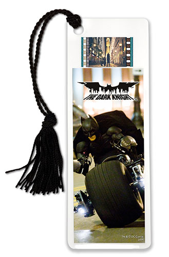 Let the excitement of Christopher Nolan's The Dark Knight be with you every time you sit down to read with this double-sided, laminated bookmark featuring an image of Batman on the Batcycle, and one clip of real 35mm film from the movie.